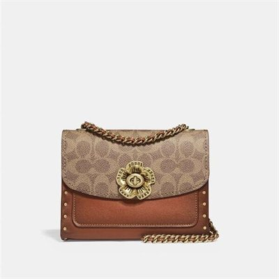 Fashion 4 Coach Parker 18 In Signature Canvas With Rivets